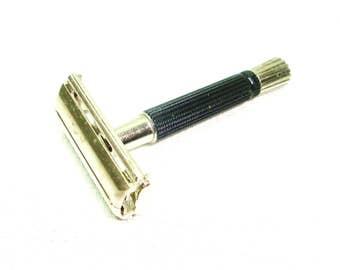 "Gillette safety razor. Vintage Gillette 1970's razor. Hard plastic grip handle. Very simple 1 piece design. 3.25"" long. Good used condition"