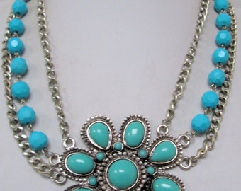 Attractive 1960s silvertone large fx turquoise flower necklace