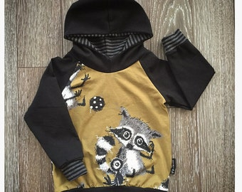 VERY limit Hoodie for baby and child, on grounds of raccoons on background khaki