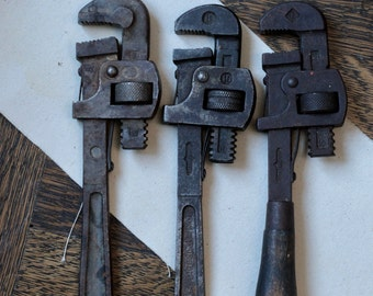 """Lot of three 10"""" antique pipe wrenches, adjustable wrench, vintage wrench."""