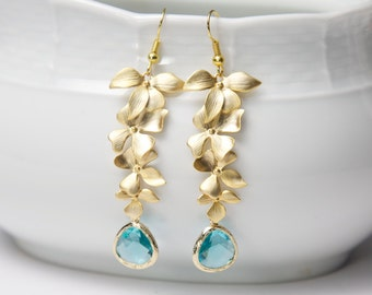 Flower Earrings, gold, with blue glass. Gold and blue earrings. Aquamarine earrings. Orchid earrings. Cascade earrings.