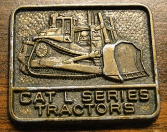 """Caterpillar Tractor Advertising Medal Fob Collectible Cat L Series Tractors Medal Fob Collectible - 1"""" X 1 1/4"""" - Great Piece!"""