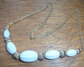 Retro style white and gilt textured bead necklet signed Avon