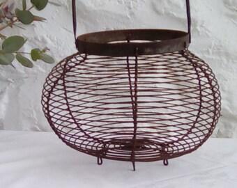 A vintage French egg basket.