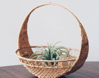 vintage wicker handled basket. woven rattan round mini planter basket. bohemian 70s air plant holder.