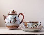 r e s e r v e d ---- antique teapot, cup + saucer with staple repair - Japanese kutani style porcelain