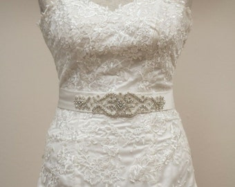Sweetheart neckline, half mermaid, lace covered bridal gown