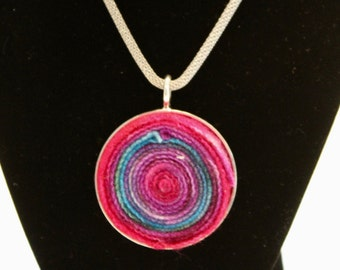 Thin rainbow colored round pendant