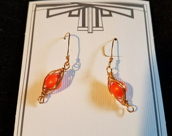 Orange wire-wrapped pea pod earrings