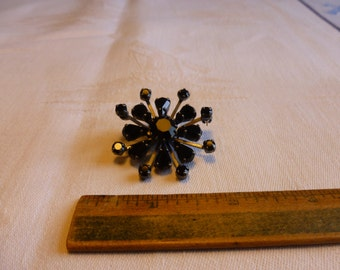 German black crystal starburst/flower brooch