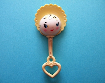 Vintage Celluloid Baby Rattle Cute Painted Face with Bonnet and Heart