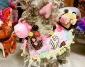 Plush Llama or Alpaca. Reversible coat with pompoms. Stuffed pack animal. Fluffy and colorful plushie. Curly tan fauxfur