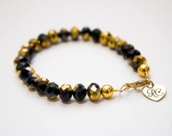 RC Signature Bracelet in Black and Gold Lustre.