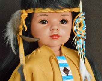 Canadian Algonquin Indian handmade porcelain 20 inch doll dressed in a leather handmade outfit, moccasins, bead work & porcupine quills