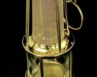 Polished Brass From Dayton's Reuge Swiss Music Box Light House Musical Decanter from Germany
