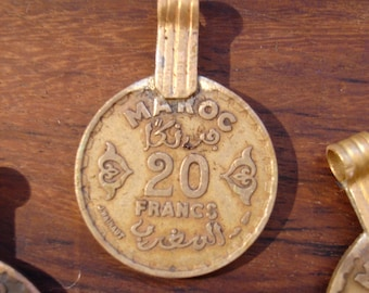 Moroccan tarnished gold colour very small  20 francs coin with brass bail or loop