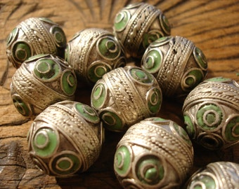 Moroccan very tarnished barrel ornate green  enamel bead