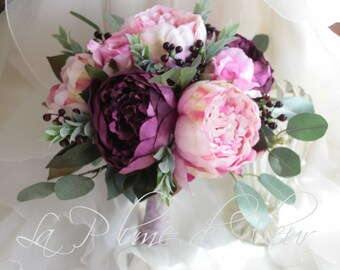 Boho wedding bouquet.  Plum purple and pale pink peonies, rich mauve roses, berries, eucalyptus gum foliage.  Plum, pink and grey bouquet