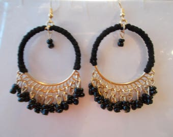 Gold Tone Chandelier Earrings with Black Tassels and Gold Tone Leaf Charm Dangles