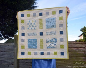 Modern unisex baby quilt, patchwork contemporary baby blanket. Makower Heartwood collection. Nature wildlife woodland quilt blue green UK
