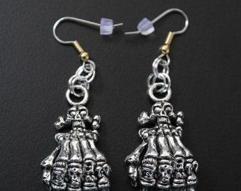 "Dangling earrings. ""Death Hands"" - hands of death"