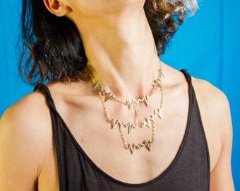 Brass and Gold Heartbeats Bib Necklace | Chic Geometric Statement Choker