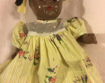 Sweet vintage Composition Black doll with pigtails
