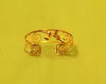 Krementz.  Gold Tone Cuff Bracelet. (395)