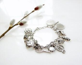60s sterling silver 13 charm bracelet