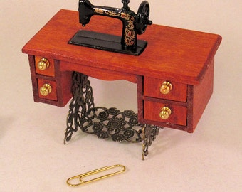 Antique treadle sewing machine 4 opening drawers, moveable foot treadle. 1 to 12 dollhouse scale miniature.Handmade in USA.
