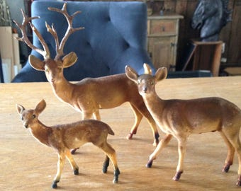 Vintage flocked deer family figurines