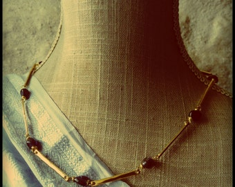 Blue Sapphire. Reproduction of an antique collar made of stone and brass.