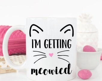 I'm getting meowied coffee mug.Getting meowied.engagement announcement.We're engaged.Engaged.Fiance.Engagement gift.Cat lover.Coffee mug