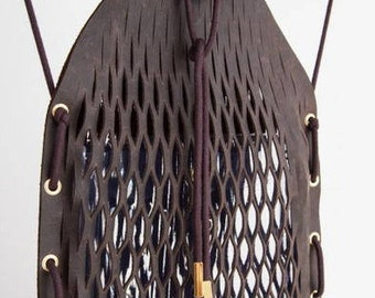Amsterdam NETPACK. A stylish leather, 'no sweat', urban and elegant backpack.