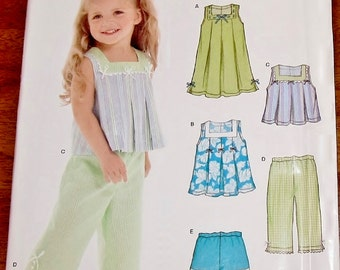 Simplicity New Look 6473 Dress Top Capri Pants Shorts Baby Toddler Girl Sewing Pattern Size 1/2 1 2 3 4 Chest 19 20 21 22 Uncut Factory Fold