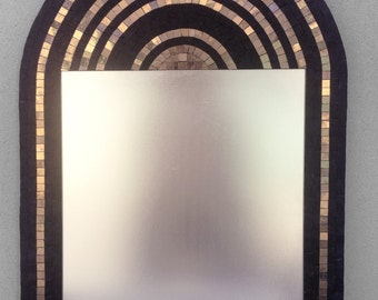Mosaic mirror decorated with white gold and black marble tiles.
