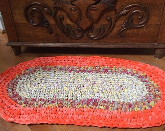 Orange and red tones oval rug