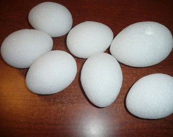 "6- 4"" , 1-5"" White Stryofoam Eggs"