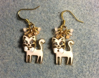 Light pink and white enamel and rhinestone cat charm earrings adorned with tiny dangling peach and pink Chinese crystal beads.