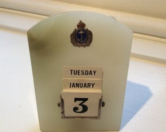 Art Deco Green Marble Perpetual Desk Calendar with Silver and Enamel Royal Navy Insignia.
