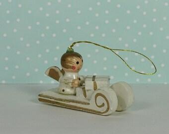 Vintage angel sled Christmas ornament white gold 1960s