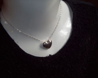 A vintage heavy sterling silver heart pendant with chain.