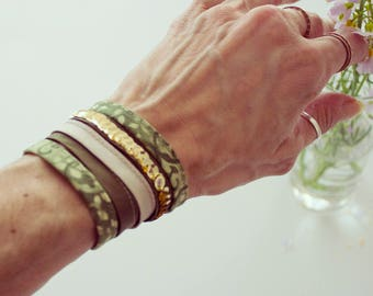 Wrist Cuff Bracelet made of Green and Beige fabric bias ribbons with gold paillettes.