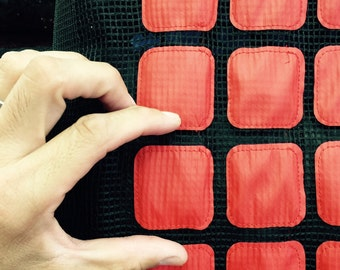 60 in w black mesh w light vinyl squares RED Fabric by the yard