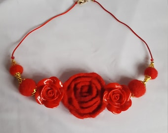 Necklace of red roses in carded wool felted with needle