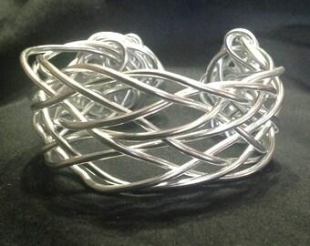 Adjustable silve  colored aluminum wire woven bracelet with florets