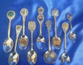 Collection of 9 African Souvenir Crested Spoons