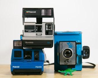 Blue Polaroid Cameras Zip, Impulse, Sun600 - Instant Collection #P103