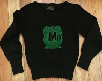 1940s collegiate ink black wool sweater with forest green chenille patch.