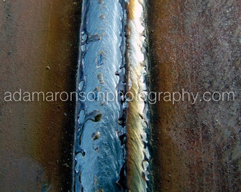 Photograph of a fresh weld on a pipeline